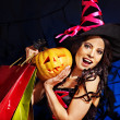 Woman holding Halloween shopping bag. — Stock Photo #32111807