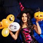 Happy woman holding pumpkin and balloon. — Stock Photo