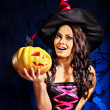 Witch holding pumpkin — Stock Photo #32111813