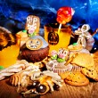 Halloween table with trick or treat — Stock Photo #32111817