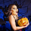 Witch holding pumpkin — Stock Photo #32111821