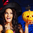 Witch holding pumpkin — Stock Photo #32111827