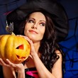 Witch holding pumpkin — Stock Photo #32111909