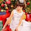 Child with gift box near Christmas tree. — Stock Photo #32111939