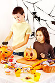 Halloween party with children holding trick or treat. — Stockfoto