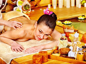 Woman getting massage in bamboo spa. — ストック写真
