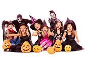 Halloween party with group kid holding carving pumpkin. — Stockfoto