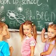 Children writing on blackboard. — Stock Photo #32533711