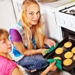Stock Photo: Mother and daughter bake cookies