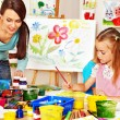 Children with teacher painting. — Stock Photo #32534047