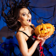 Witch holding pumpkin — Stock Photo #32534159