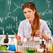 Chemistry teacher at classroom. — Stock Photo