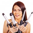 Woman holding iron curling hair. — Stock Photo #32534343