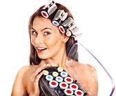 Woman holding hair curlers for head. — Stock Photo