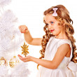 Child holding snowflake to decorate Christmas tree . — Stock Photo #32946229