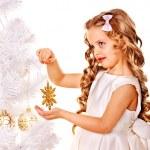 Child holding snowflake to decorate Christmas tree . — Stock Photo