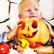 Child holding Halloween pumpkin carving . — Stock Photo #32946295