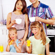Stock Photo: Parents prepare breakfast.