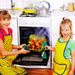 Children cooking chicken at kitchen. — Stock Photo #32946427