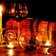 Wine glass and candle on dark — Photo