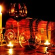 Wine glass and candle on dark — 图库照片