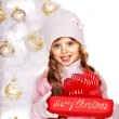 Child holding red gift box — Stock Photo