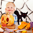 Child holding Halloween pumpkin carving . — Stock Photo
