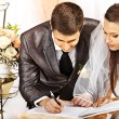 Groom and bride register marriage — Stock Photo
