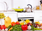 Interior of kitchen with vegetables. — Stock Photo