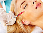 Woman giving botox injections. — Stock Photo