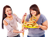 Woman holding fast food — Stock Photo