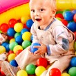 Child in colored ball. — Stock Photo #33926967