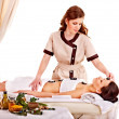 Woman getting spa lastone therapy outdoor. — Foto de Stock
