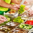Tray with  food  on showcase at cafeteria — Stockfoto