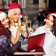Women in santa hat drinking champagne. — Stock Photo #33927193