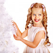 Child decorate white Christmas tree. — Foto de Stock