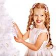 Child decorate white Christmas tree. — Stock Photo