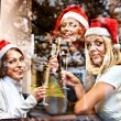 Women in santa hat drinking champagne. — Foto Stock