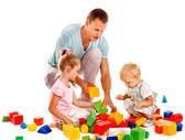 Children play building blocks. — Stock Photo