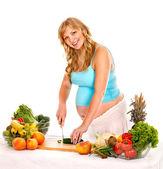 Pregnant woman preparing food . — Stock Photo