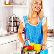 Woman washing fruit at kitchen. — Stock Photo #34547481