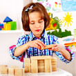 Stock Photo: Child playing bricks.