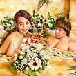 Couple relax  at spa with flower. — Stock Photo