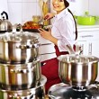 Woman cooking chicken at kitchen. — Stock Photo