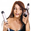 Woman holding iron curling hair. — Stock Photo