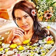 Woman at flower spa. — Stock Photo