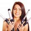 Stock Photo: Woman holding iron curling hair.