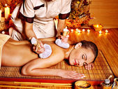 Woman getting herbal ball massage . — Stockfoto