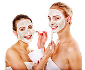 Woman getting facial mask. — Stock Photo