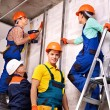 Stock Photo: Group people in builder uniform.